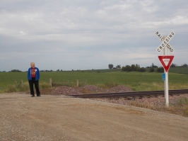 The quintessential country road, complete with the railway crossing.