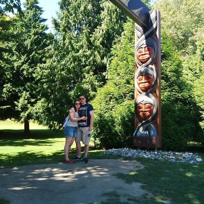 Sarah, Stewart and the totem arch in Stanley Park
